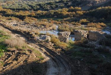 Daños en el puente romano de Porcuna por obras en el río