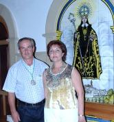 Entrega de banderas a los nuevos Hermanos Mayores de la Virgen de Alharilla